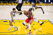 Golden State Warriors guard Klay Thompson (11) strips the ball from Houston Rockets forward Luc Mbah a Moute (12) at Oracle Arena in Oakland, Calif., on October 17, 2017. (Stan Olszewski/Special to S.F. Examiner)