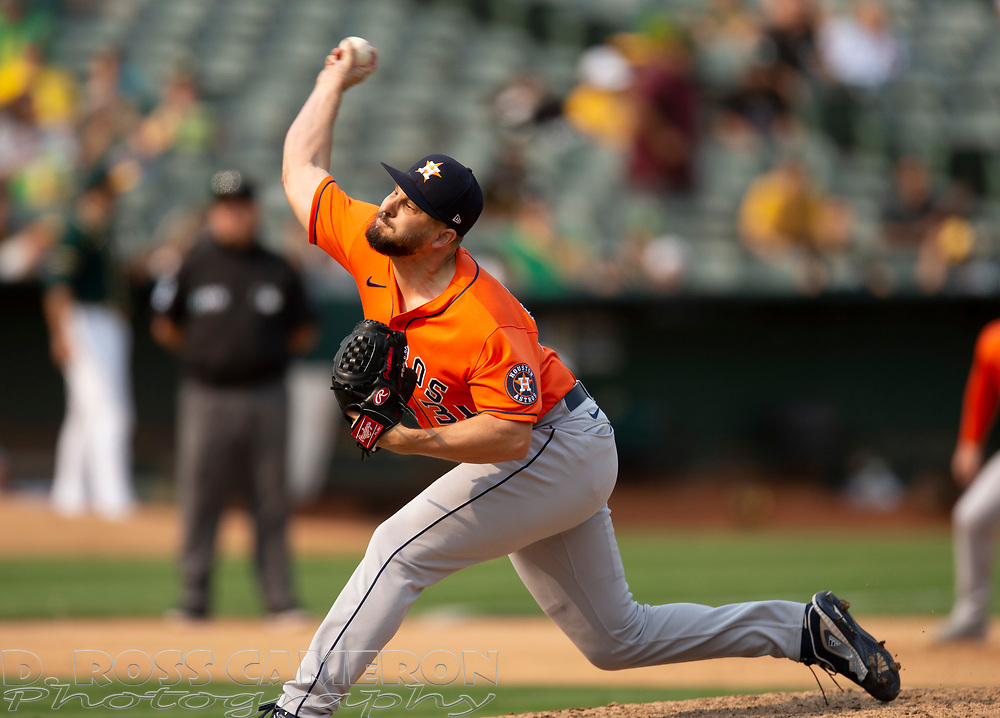 Sep 25, 2021; Oakland, California, USA; Houston Astros pitcher Kendall Graveman (31) delivers a pitch against the Oakland Athletics during the seventh inning at RingCentral Coliseum. Mandatory Credit: D. Ross Cameron-USA TODAY Sports