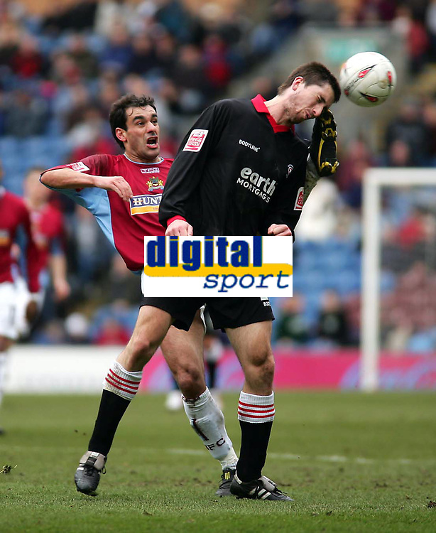 Photo. Andrew Unwin.<br /> Burnley v Rotherham, Coca-Cola Championship, Turf Moor, Burnley 12/03/2005.<br /> Rotherham's Shaun Barker (R) battles bravely with Burnley's Jean Louis Valois (L).