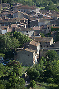 Aerial landscape overlooking the pretty French medieval walled village of Lagrasse on the River Orbieu, on 23rd May, 2017, in Lagrasse, Languedoc-Rousillon, south of France. Lagrasse is listed as one of Frances most beautiful villages and lies on the famous Route 20 wine route in the Basses-Corbieres region dating to the 13th century.
