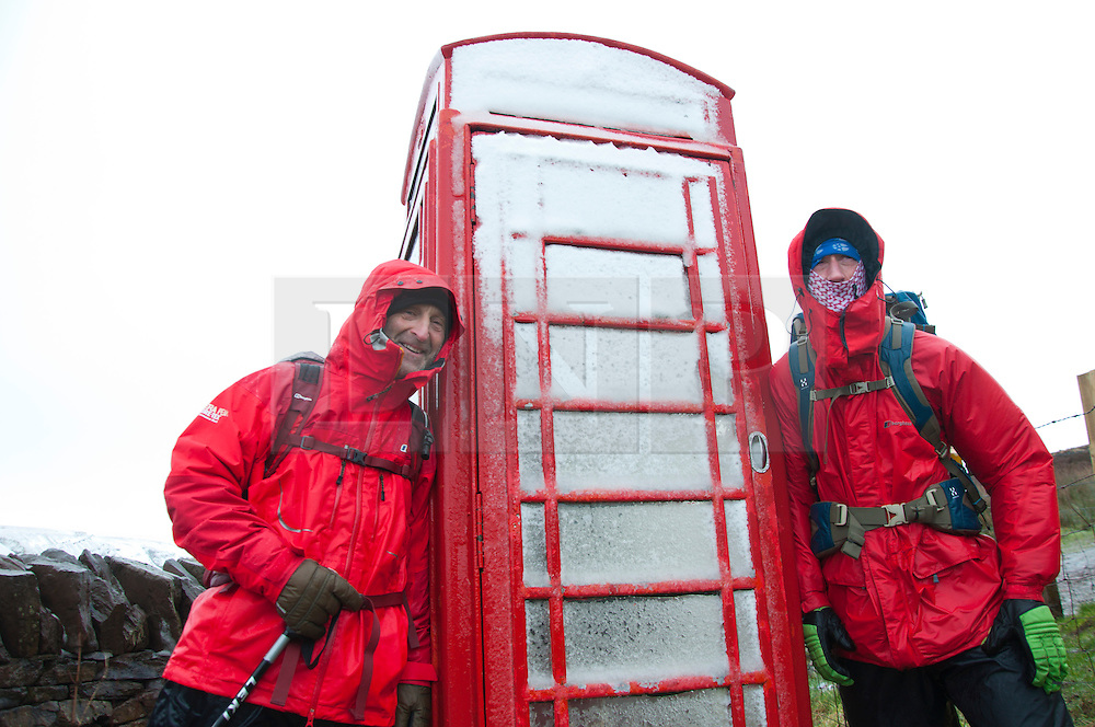 © Licensed to London News Pictures. 14/02/2014. Storey Arms, Brecon Beacons, Powys, Wales, UK. Steve Hamer 50 (R) from Camberley and Charlie Pert  55 (L) from Heathrow,down in Wales for two days holiday tried to climb Pen-Y-Fan, the highest summit of the Beacons but conditions were too horrendous and only made halfway. Snow, driving hail and storm force winds hit the Brecon Beacons. Photo credit : Graham M. Lawrence/LNP