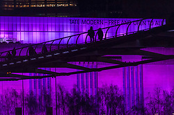 © Licensed to London News Pictures. 08/03/2018. LONDON, UK.  Tate Modern (pictured) and Tate Britain are lit up in a magenta colour to mark International Women's Day.  The colour was chosen by the HeForShe UN Women's solidarity campaign encouraging all genders to stand for gender equality.  Photo credit: Stephen Chung/LNP