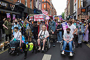 Thousands of people pass through Soho on a London Trans+ Pride march from the Wellington Arch to Soho Square on 26th June 2021 in London, United Kingdom. London Trans+ Pride is a grassroots protest event which is not affiliated with Pride in London and focuses on creating a space for the London trans, non-binary, intersex and GNC community to come together to celebrate their identities and to fight for their rights.