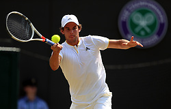 Dominic Thiem in action against Gilles Simon on day four of the Wimbledon Championships at The All England Lawn Tennis and Croquet Club, Wimbledon.