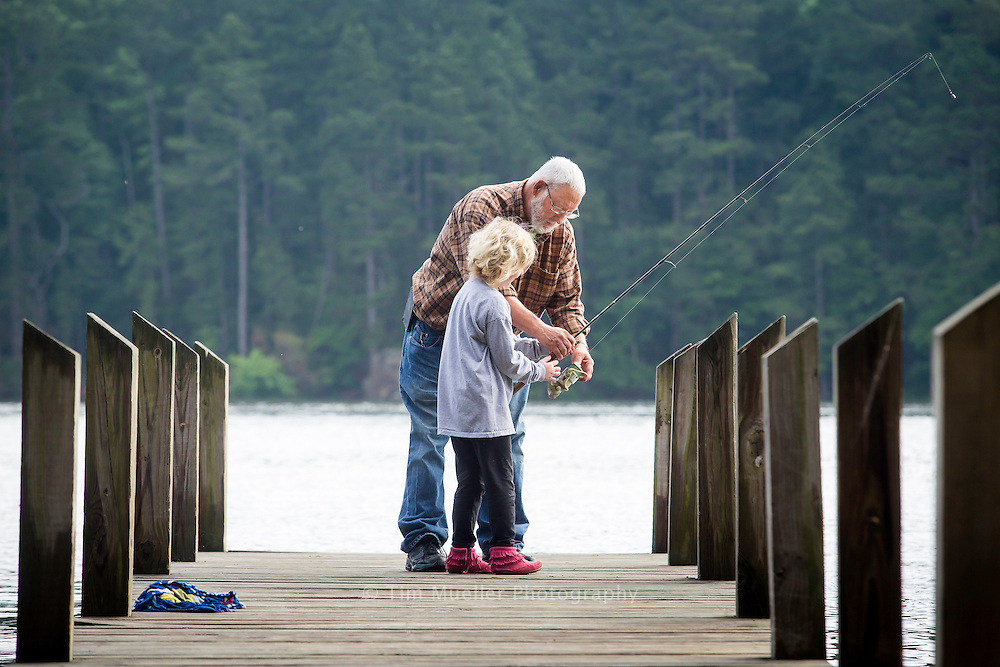 Gerald Griffin helps Emma Medders cast her fishing line off a pier at Lake Claiborne State Park. The freshwater lake is stocked with largemouth bass, bluegill, channel catfish, black crappie, striped bass and perch. The lake itself, at full reservoir level, has a surface area of 6,400 acres.