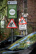 Transport for London's (TFL) new signposts for the new Ultra Low Emissions Zone (ULEZ) have been erected around the inner orbital road perimeter around the capital, and seen on the South Circular in East Dulwich on the day that the new area becomes effective for newer vehicles, on 25th October 2021, in London, England. Now 18 times larger, the new ULEZ area bans older vehicles such as polluting diesels and petrol cars older than 2006, an attempt to lower poisonous emissions that further harm the health of 1 in 10 children who have asthma. Drivers of non-exempt vehicles may enter the ULEZ after paying a £12.50 daily fee - or face a £160 penalty.