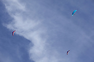 Ellenville, NY - Two hang gliders and a paragliders soar in the sky on Oct. 25, 2009.