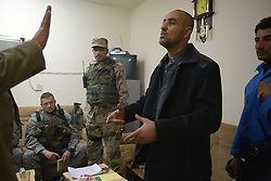 Members of the 1st Infantry, 17th Regiment, are seen before they help Iraqi forces patrol western Mosul, Iraq, Dec. 13, 2005. This is part of an effort to provide security in preparation for Iraq's first post-Saddam parliamentary elections. The western sector is home to Mosul's primarily Sunni population, which has been resistant to the American presence in Iraq.