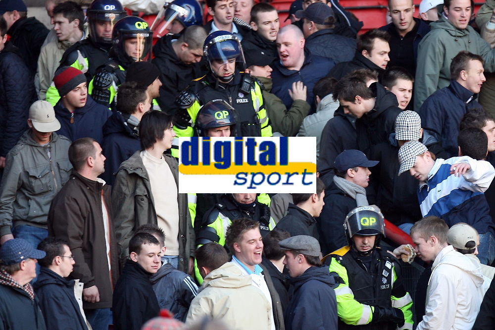 Photo: Rich Eaton.<br /> <br /> Bristol City v Millwall. Coca Cola League 1. 16/12/2006. Millwall fans appear a little agitated as their team go 1-0 down and the police calm them down