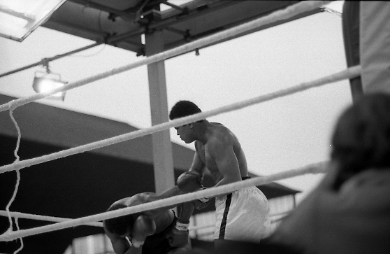 Ali vs Lewis Fight, Croke Park,Dublin..1972..19.07.1972..07.19.1972..19th July 1972..As part of his built up for a World Championship attempt against the current champion, 'Smokin' Joe Frazier,Muhammad Ali fought Al 'Blue' Lewis at Croke Park,Dublin,Ireland. Muhammad Ali won the fight with a TKO when the fight was stopped in the eleventh round...Image shows Ali beginning to take control of the flight as he hits Lewis with a swinging right.