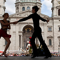 Dancers perform on stage during the advertising festival of the Debrecen Flower Carnaval held at St Steven square in Budapest, Hungary. Saturday, 11. July 2009. ATTILA VOLGYI