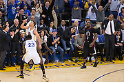 Golden State Warriors guard Stephen Curry (30) celebrates with forward Draymond Green (23) after hitting a three pointer against the LA Clippers at Oracle Arena in Oakland, Calif., on February 23, 2017. (Stan Olszewski/Special to S.F. Examiner)