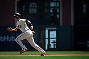 San Francisco Giants first baseman Buster Posey (28) runs to second base during a hit against the Los Angeles Dodgers at AT&T Park in San Francisco, California, on April 27, 2017. (Stan Olszewski/Special to S.F. Examiner)