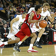Louisiana's guard Raymone Andrews (22) drives past Central Florida center Tom Herzog (41)  during their game at the UCF Arena on December 15, 2010 in Orlando, Florida. UCF won the game79-58. (AP Photo/Alex Menendez)