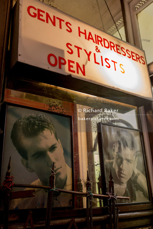 A detail of an old fashioned barber shop in a backstreet on 2nd February 2017, in the City of London, England.