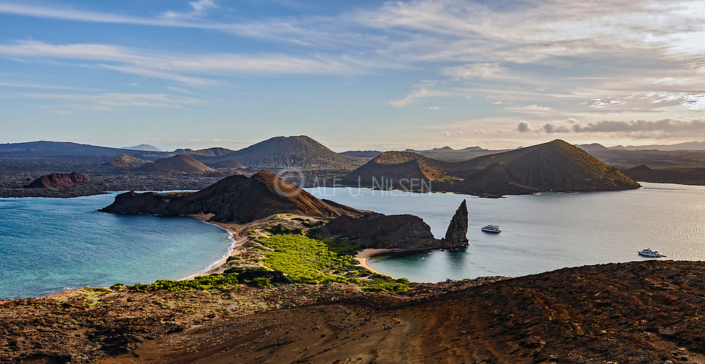 Bartholome Island with the famous Pinnacle Rock and Sullivan bay. In the background Santiago Island.