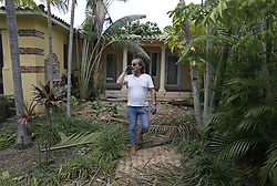 Homeowner Richard Todaro, owner of a home in the Bayshore, cleans debris in the Hurricane Irma aftermath on Tuesday, September 12, 2017, in Miami Beach. Photo by David Santiago/El Nuevo Herald/TNS/ABACAPRESS.COM