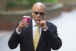 © London News Pictures. 05/06/2013. London, UK. PAUL EDWARDS, a former driver to Rebekah Brooks, leaving Southwark Crown Court in London where he faced charges relating to phone hacking scandal at the News of The World. Photo credit: Ben Cawthra/LNP