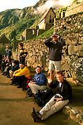 PERU, PREHISPANIC, INCA Machu Picchu; tour group and guide