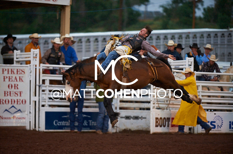 Bareback rider Justin Miller of Billings, MT rides Misty Valley at the Pikes Peak or Bust Rodeo in Colorado Springs, CO.<br /> <br /> <br /> UNEDITED LOW-RES PREVIEW<br /> <br /> <br /> File shown may be an unedited low resolution version used as a proof only. All prints are 100% guaranteed for quality. Sizes 8x10+ come with a version for personal social media. I am currently not selling downloads for commercial/brand use.