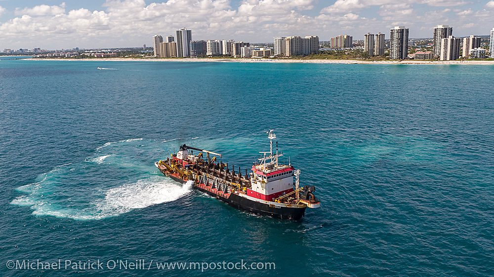 A dredging ship extracts sand from the seabed near Singer Island, Florida to rebuild beaches in Palm Beach that have partially disappeared due to erosion and global warming.