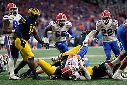 Florida Gators quarterback Feleipe Franks #13 is tackled during the Chick-fil-A Peach Bowl, Saturday, December 29, 2018, in Atlanta. ( Paul Abell via Abell Images for Chick-fil-A Peach Bowl)