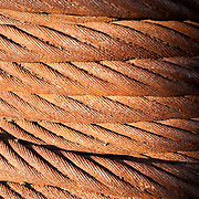 Rusted cables on a spool, on a pier in Gloucester, Massachusetts