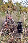 Keith Crowley and his Black Labrador Retriever, Elsie, following a successful diver hunt.