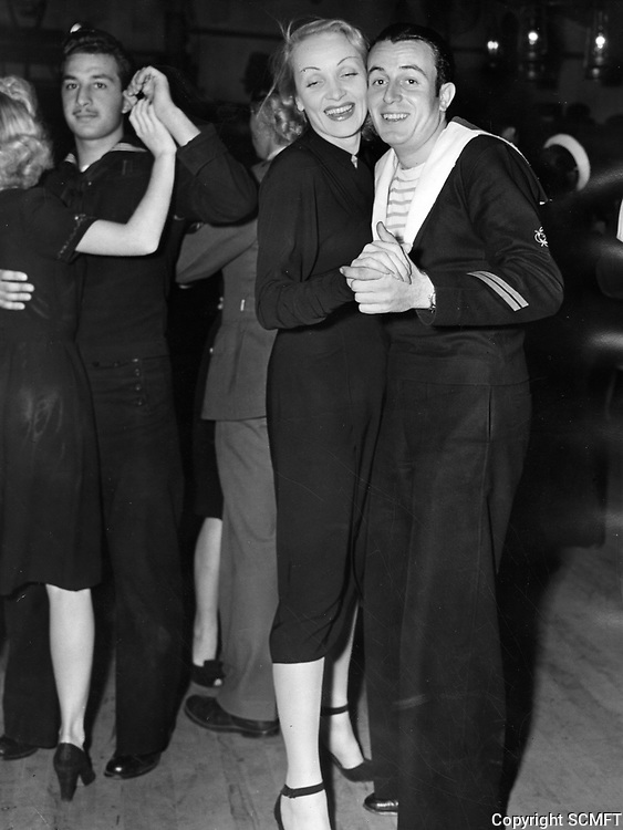 11/6/43 Marlene Dietrich dances with a French sailor at the Hollywood Canteen.
