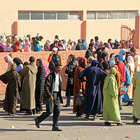 North Africa, Africa, Morocco.  Crowds of students outside a college in Morocco.