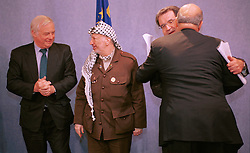 BRUSSELS, BELGIUM - MAY 31, 2001 - Chris Patten, External Relations Commissioner for the European Union (left), talks with Yasser Arafat, leader of the PLO, while Romano Prodi, President of the European Commission greets Nabeel Shaath, Minister of Planning and International Cooperation for the Palestian National Authority, at  the European Commission, in Brussels, Thursday. (PHOTO © JOCK FISTICK)