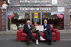 "© licensed to London News Pictures. London, UK 06/08/2012. Maurice (L) and Trevor Reeves (R), the owners of the House of Reeves furniture store and British singer-songwriter Delilah (centre) posing outside the shop which was burnt down in last year's riots. The shop has been covered in 4000 images of young people with positive messages on August 6, 2012 in Croydon. The youth volunteering charity ""vInspired"" are marking the one year anniversary of the riots in Croydon by displaying thousands of images of young Britons holding up positive messages about themselves on the House of Reeves furniture store which was destroyed in last year's violence. British singer-songwriter Delilah is one of the supporters of the volunteering charity ""vInspired"". Photo credit: Tolga Akmen/LNP"