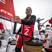 Leg 02, Lisbon to Cape Town, day 18, on board MAPFRE, Joan Vila lookimg at the horizon to analize the wind. Photo by Ugo Fonolla/Volvo Ocean Race. 22 November, 2017