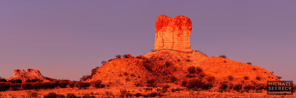 Sunset glow on Chamber's Pillar, an isolated mesa formation south of Alice Springs, in arid desert country.<br /> <br /> Limited Edition of 125 Prints