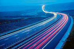Modern rural motorway with traffic lights trail