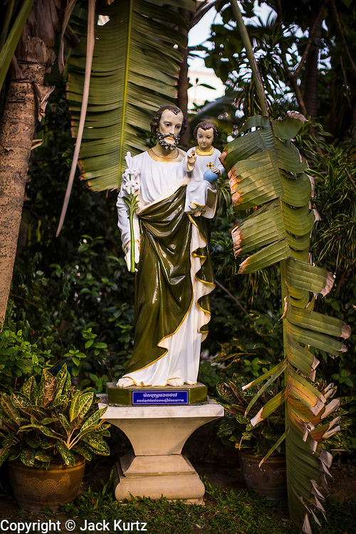 02 APRIL 2013 - PATTAYA, CHONBURI, THAILAND: A statue of Joseph holding the baby Jesus at the Ray Resort, in Pattaya, Thailand. The Ray Resort is a Catholic resort and conference center.      PHOTO BY JACK KURTZ