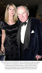MR & MRS GAY KINDERSLEY former leading amateur jockey, at a dinner in London on 30th November 2001.OUT 81