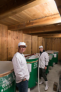 CEO Yoshihiro Wakizaka and a member of staff, Nekka Shochu Distillery, Tadami, Fukushima, Japan, February 20, 2018. The Nekka shochu distillery was founded in July 2016 and at that time was the smallest shochu distillery in Japan. It makes shochu from locally-grown rice, and is helping support a local economy that has languished since the nuclear disaster of 2011.
