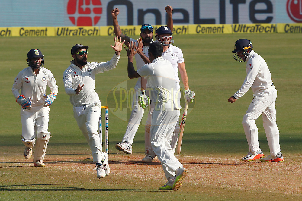 Virat Kohli Captain of India along with team mates celebrates the wicket of Jonny Bairstow of England during day 5 of the fourth test match between India and England held at the Wankhede Stadium, Mumbai on the 12th December 2016.<br /> <br /> Photo by: Deepak Malik/ BCCI/ SPORTZPICS