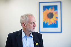 © Licensed to London News Pictures . 24/09/2016 . Liverpool , UK . JEREMY CORBYN visits Beaconsfield Community House in Birkenhead , following his victory declaration . The centre provides clothes and food that would otherwise be destined for waste from supermarkets , to local residents in need . Photo credit : Joel Goodman/LNP