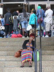 A woman rests on the steps while joining hundreds of other local residents being evacuated from the city at the Savannah Civic Center during a mandatory evacuation for Hurricane Irma on Saturday, September 9, 2017, in Savannah, Ga. Officials are expecting 1,500 to 3,000 without transportation to leave by buses that are being provided. Photo by Curtis Compton/Atlanta Journal-Constitution/TNS/ABACAPRESS.COM