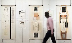 South Africa - Pretoria - 27 August 2020 - A man walks past drawings and collages by South African artist Majak Bredell from her exhibiton, Majak Bredell: The New York years: 1981 - 2003 on at the Pretoria Art Museum.  They are open again Tuesday to Friday from 10am to 4pm and Saturdays from 10am to 2pm, R5 for children, R12 for students and pensioners and R25 for adults, dont forget your mask.<br /> Photo: Jacques Naude/African News Agency(ANA)