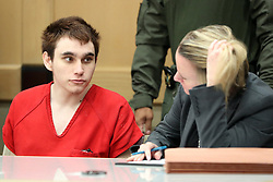 Parkland school shooter Nikolas Cruz speaks with Public Defender Melisa McNeill before a pre-trial hearing at the Broward County Courthouse in Fort Lauderdale, FL, USA on Monday, January 27, 2020, on four criminal counts stemming from his alleged attack on a Broward jail guard in November 2018. Cruz is accused of punching Sgt. Ray Beltran, wrestling him to the ground and taking his stun gun. Photo by Amy Beth Bennett/Sun Sentinel/TNS/ABACAPRESS.COM