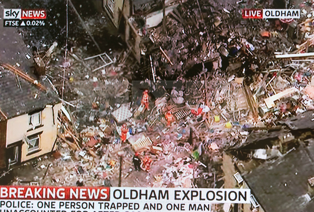 © Licensed to London News Pictures. SCREEN PHOTO FROM SKY NEWS. 26/06/2012. Oldham , UK . A large explosion , believed to be caused by gas , has brought down at least one house in an Oldham terrace. Police and search and recovery fire teams are searching the scene . Photo credit : Joel Goodman/LNP