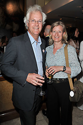PETER & EMILY MACKIE at a party to celebrate the publication of 'Garden' by Randle Siddeley held at Linley, 60 Pimlico Road, London on 24th May 2011.