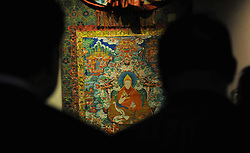 LHASA, Sept. 12, 2016 (Xinhua) -- Visitors watch a Thangka painting displayed at an exhibition in the Potala Palace in Lhasa, capital of southwest China's Tibet Autonomous Region, Sept. 12, 2016. An exhibition of 105 cultural relics selected from the collection of the Potala Palace started on Monday here.  (Xinhua/Jigme Dorje) (zhs) (Credit Image: © Jigme Dorje/Xinhua via ZUMA Wire)