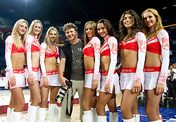 Cheerleaders Red Foxes and photographer Vid Ponikvar after the finals basketball match between National teams of Turkey and USA at 2010 FIBA World Championships on September 12, 2010 at the Sinan Erdem Dome in Istanbul, Turkey.  USA defeated Turkey 81 - 64 and became World Champion 2010. (Photo By Vid Ponikvar / Sportida.com)