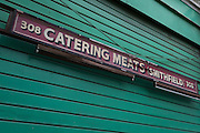 Closed shutters on a butchers business in Smithfield Market, on 9th February 2017, in City of London, England.
