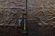 A unpolished old hammered brass door dated 1764 in the historic center of San Miguel de Allende, Guanajuato, Mexico.