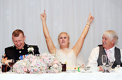 Football-mad bride Nadine Hanlon, her husband Lee (left) and father Kevin Kent react while watching coverage of the FIFA World Cup 2018 quarter-final match between Sweden and England during their wedding breakfast at the Regent Hotel in Doncaster.